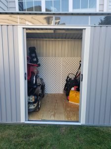 A front shot of the pent metal shed.